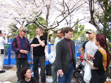 hanami revelers in the foreign section of Aoyama cemetery